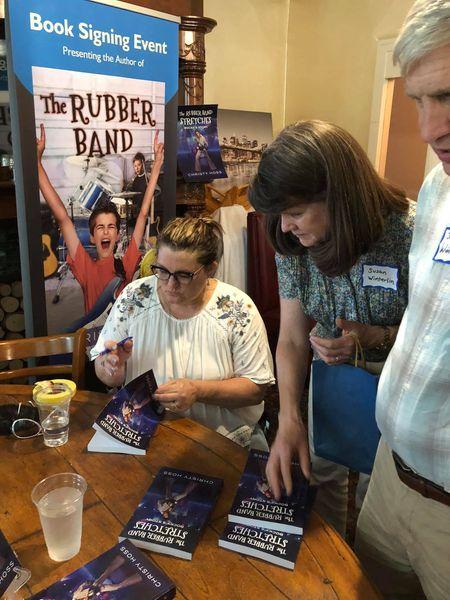 Christy Hoss signing books